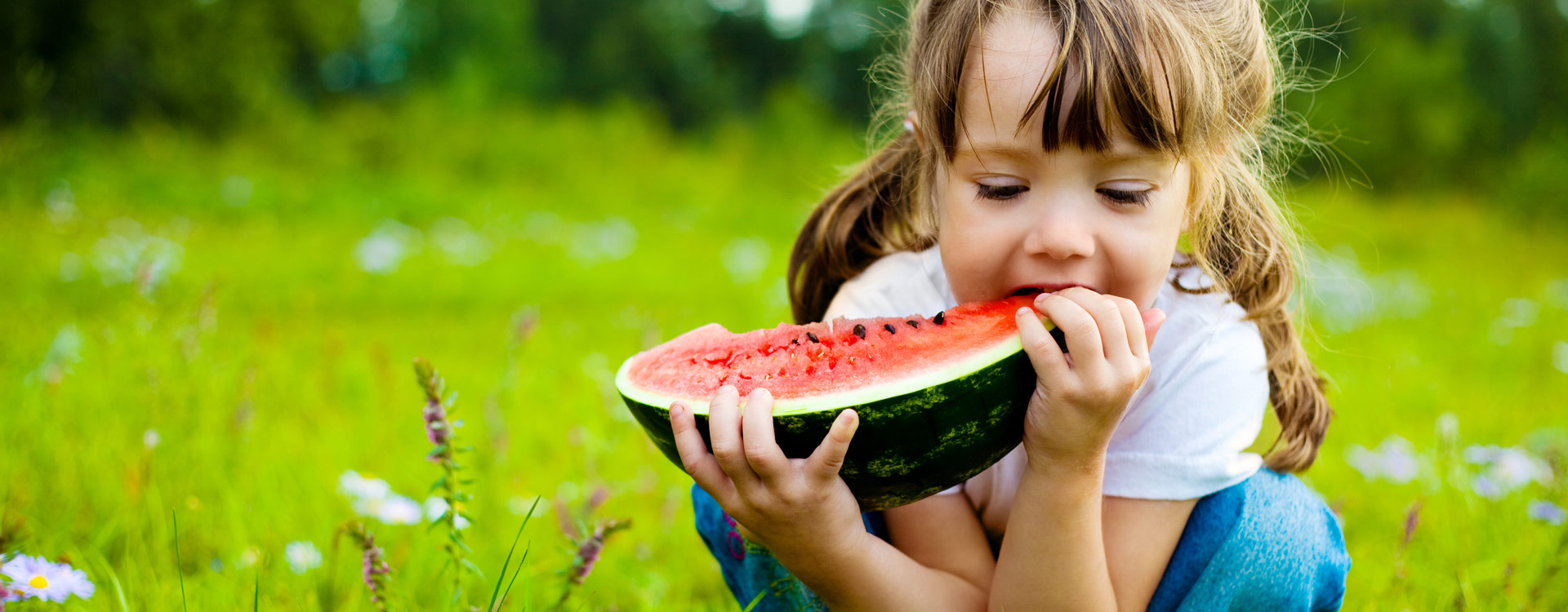 girl eating watermelon snack